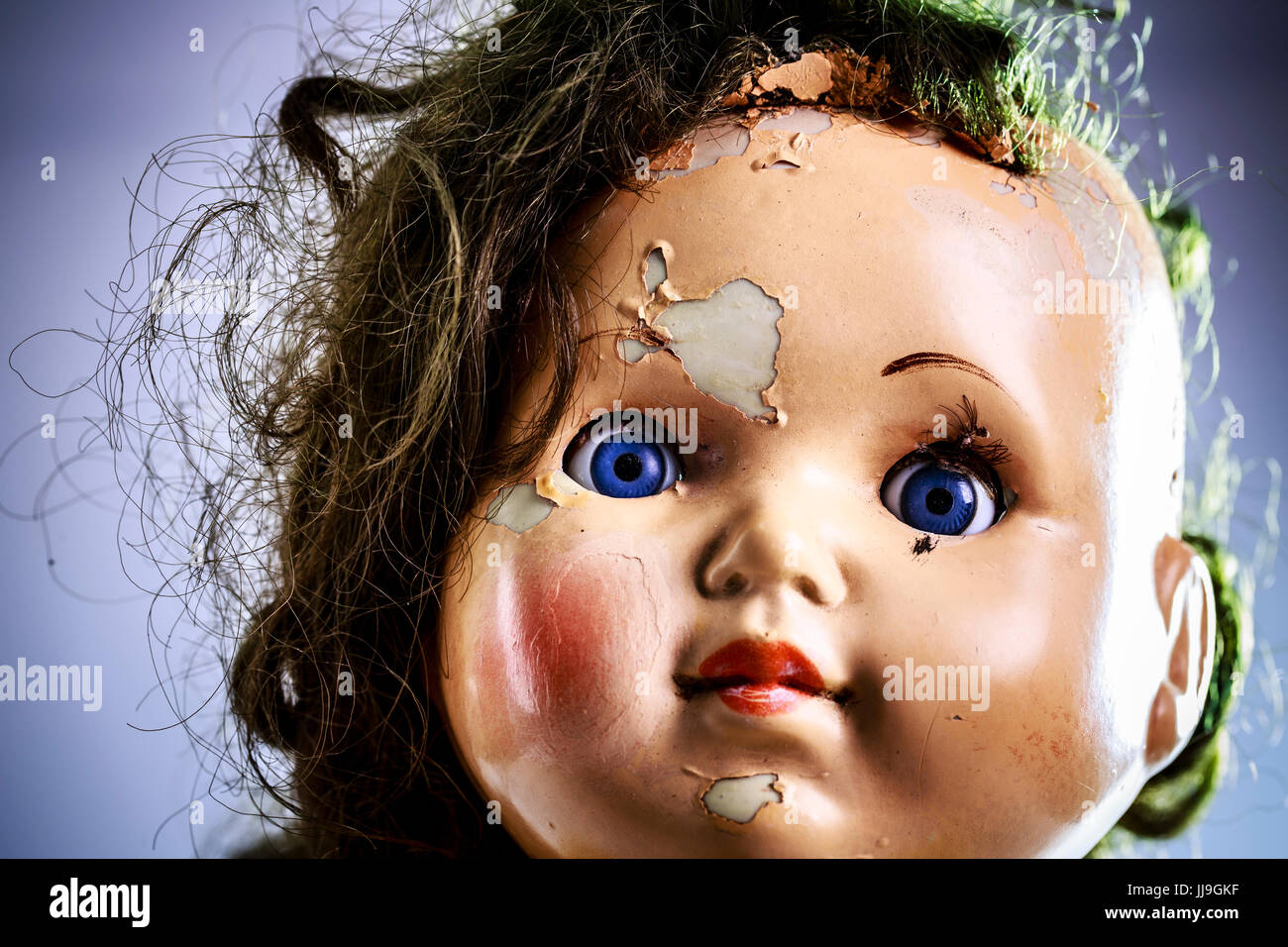 head of beatiful scary doll like from horror movie evil face stock