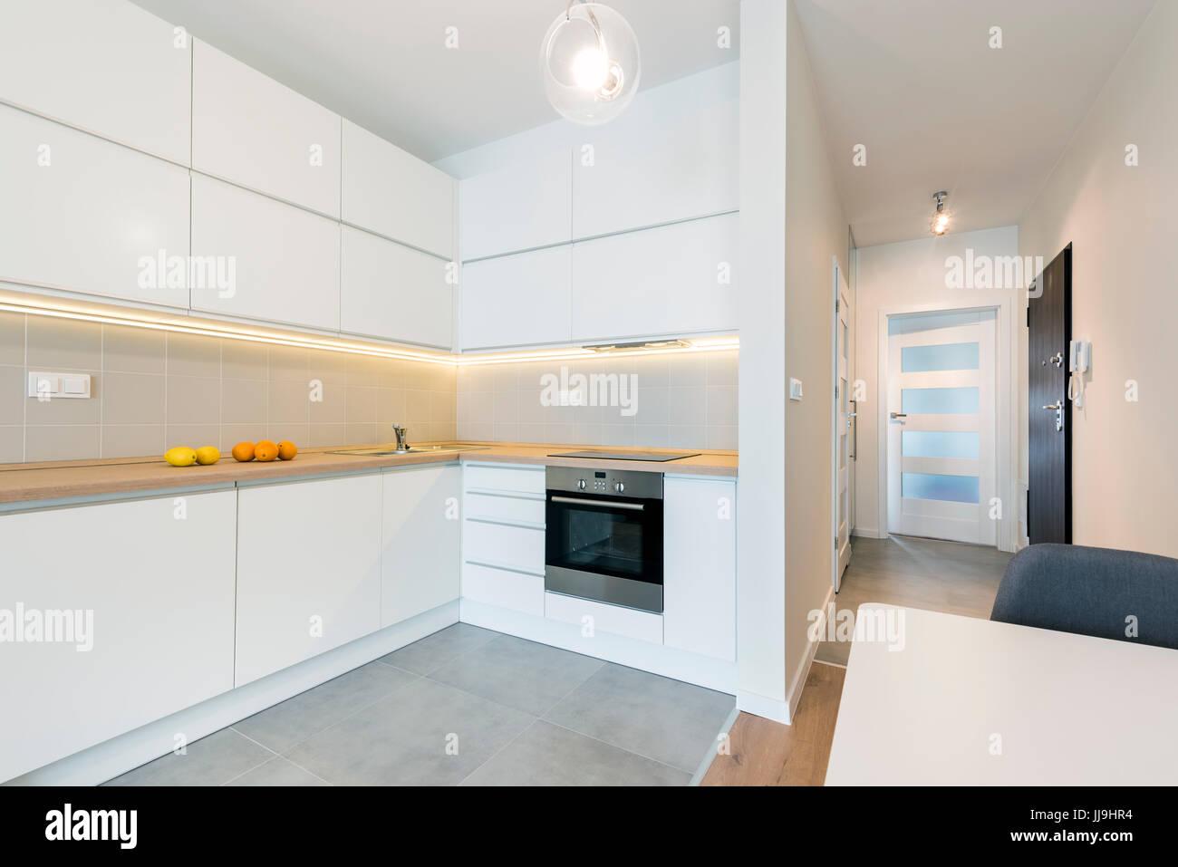 Modern Kitchen Interior Design In White Finishing In Small Apartment Stock Photo Alamy