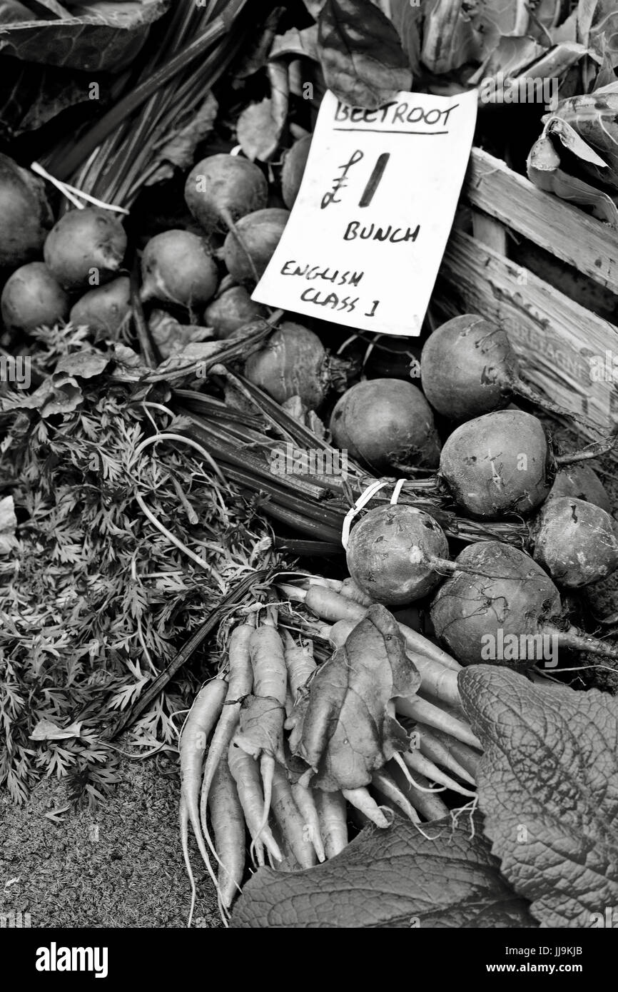 black and white photograph of beetroot on sale in market at one pound per bunch - Stock Image