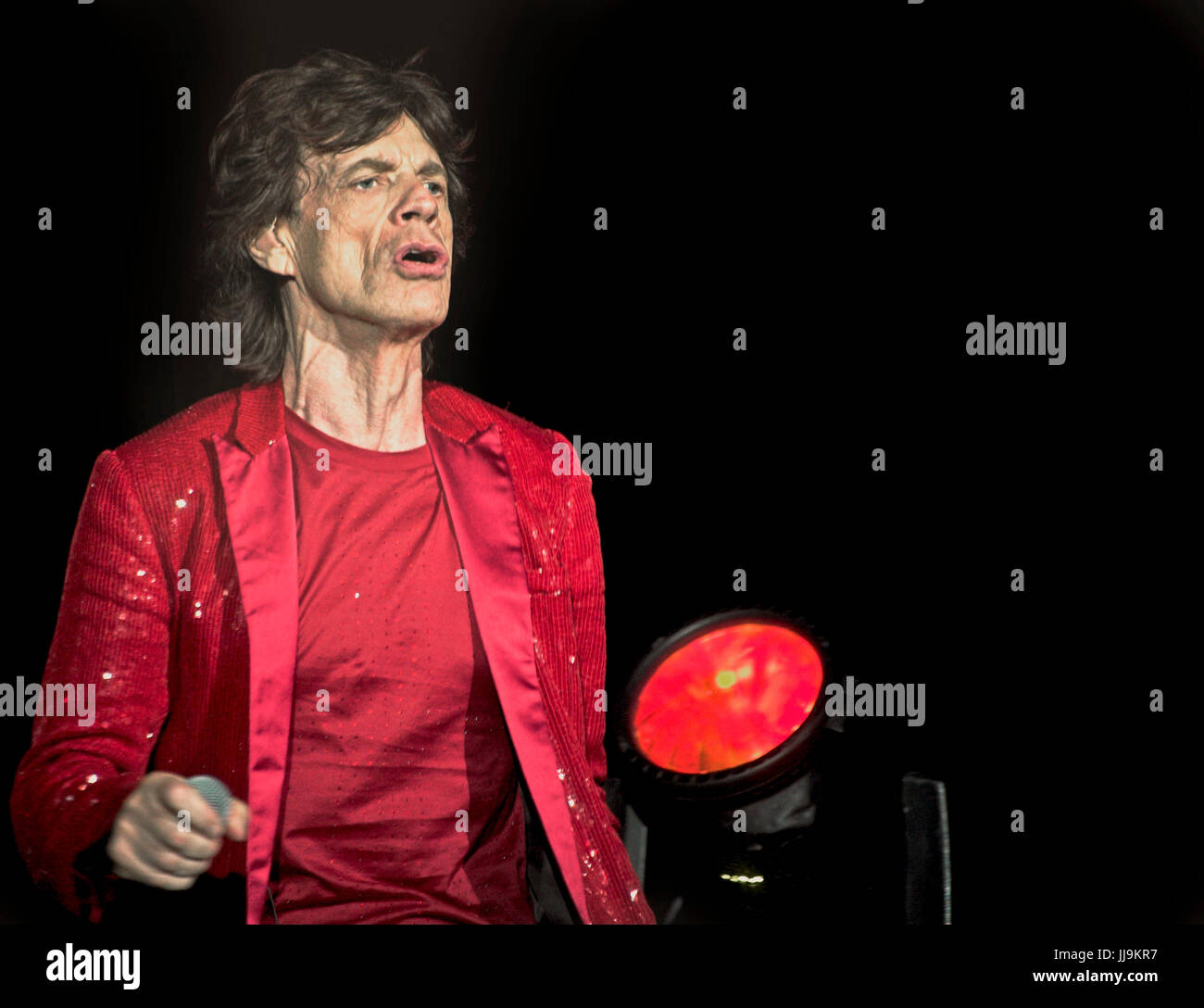 Mick Jagger Rolling Stones on stage in red jacket - Stock Image