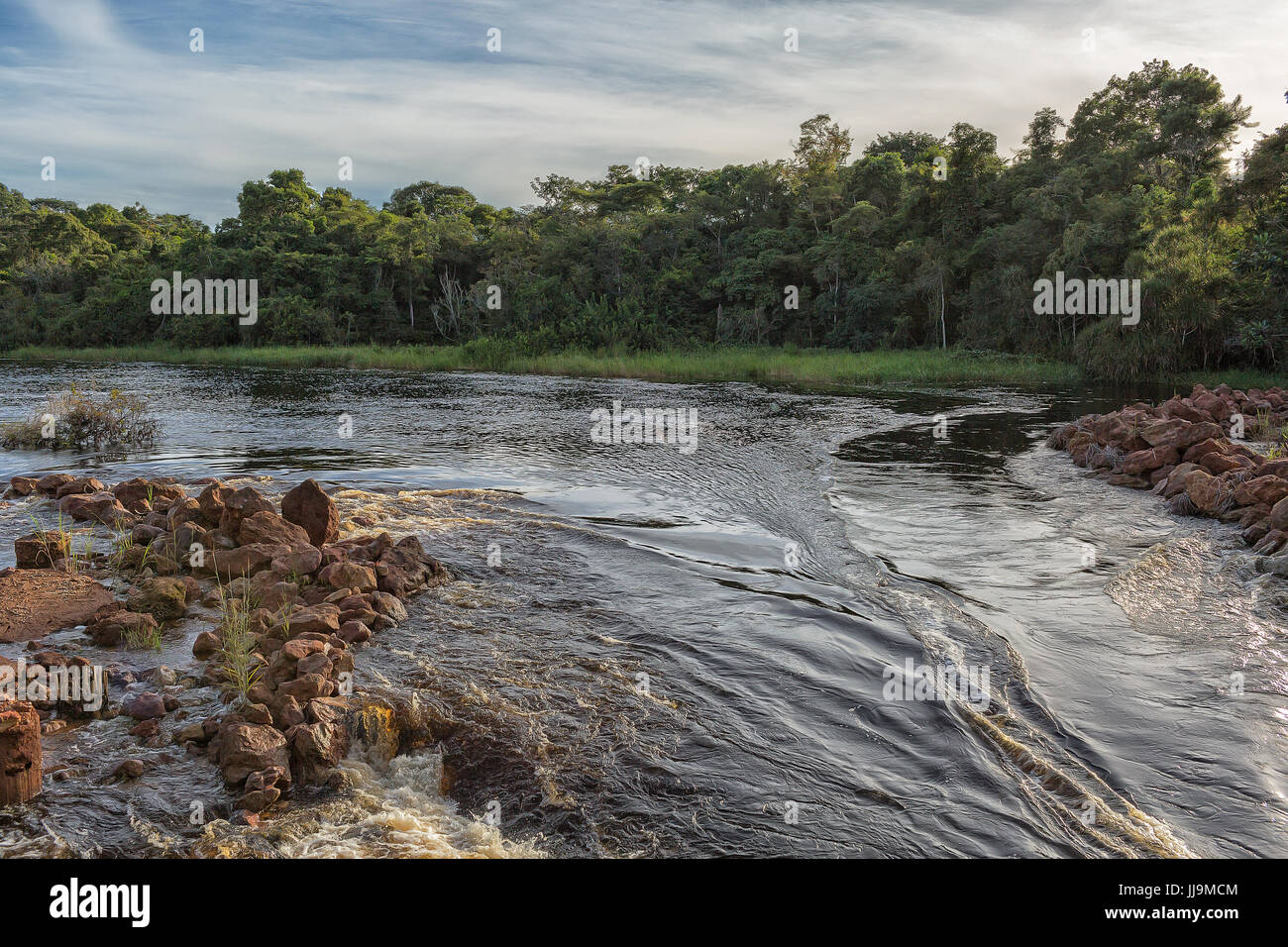 Fluent African river in Angola. - Stock Image