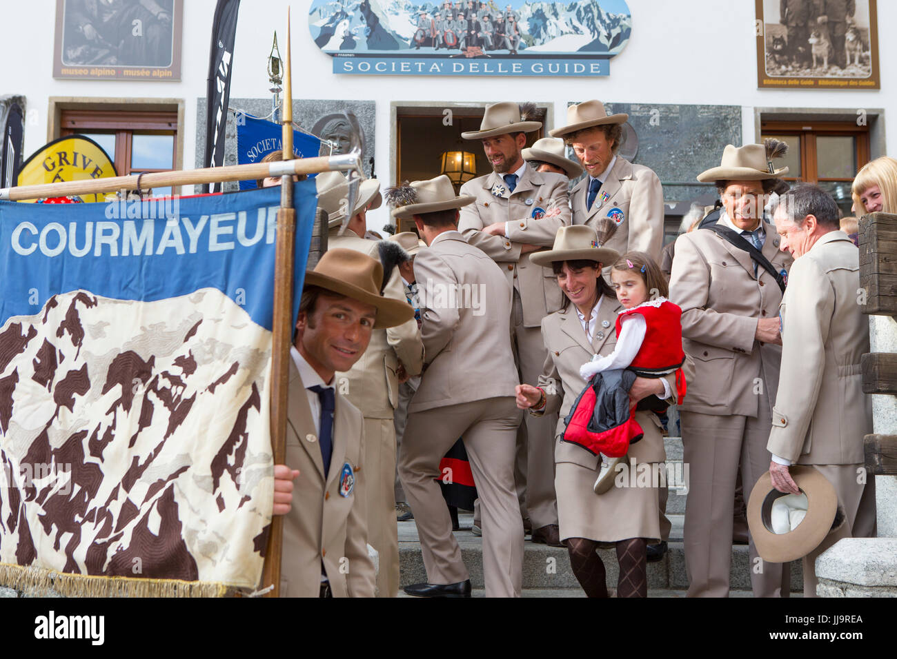 A group of Italian mountain guides are dressed in traditional clothing of the Guide Alpine Courmayeur for a parade Stock Photo
