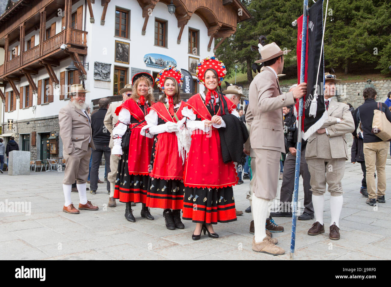 A group of Italian mountain guides are dressed in traditional clothing of the Guide Alpine Courmayeur for a parade - Stock Image