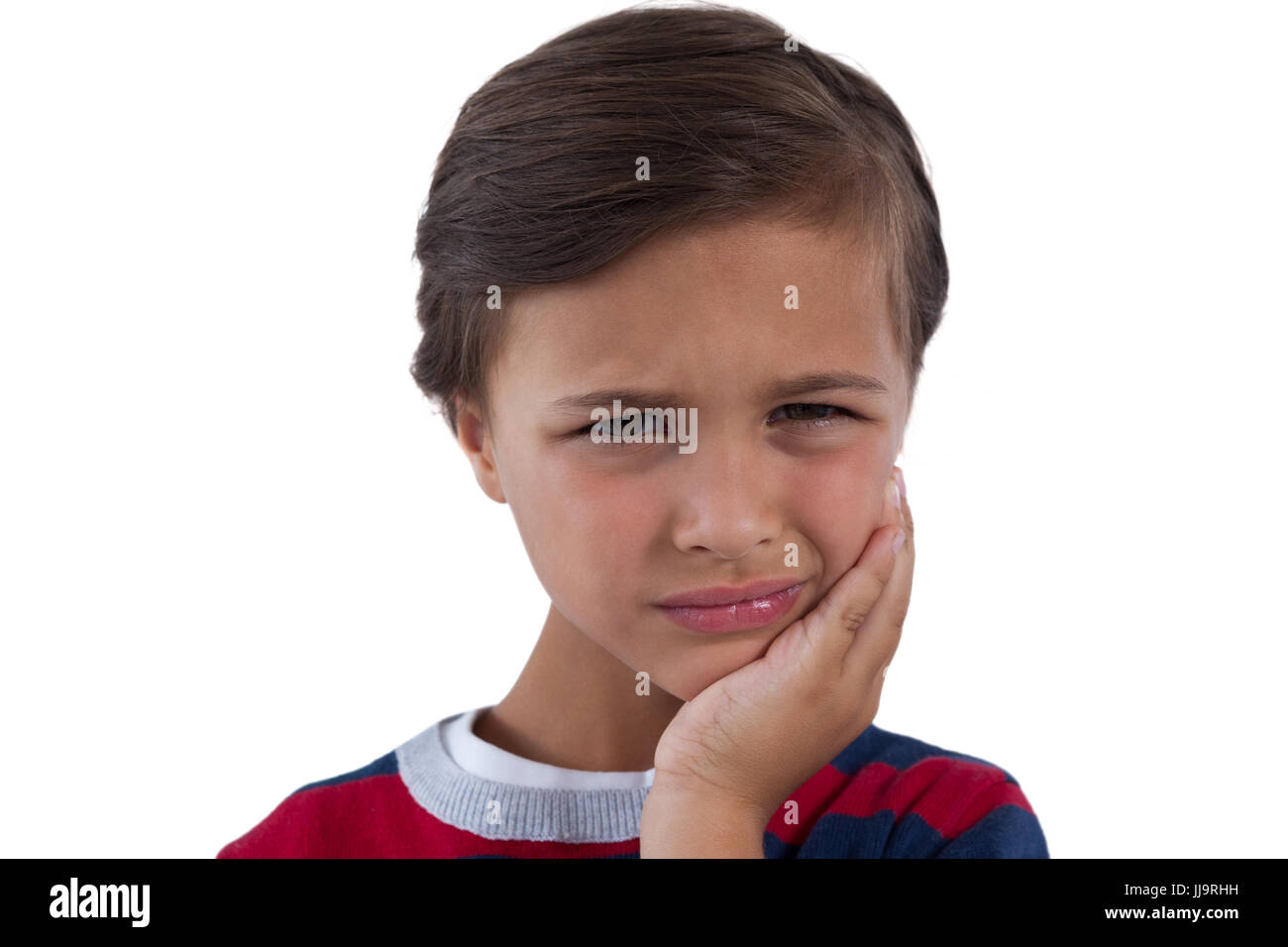 Close-up of cute boy having an toothache - Stock Image