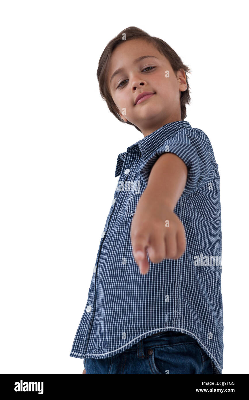 Portrait of boy pointing finger - Stock Image