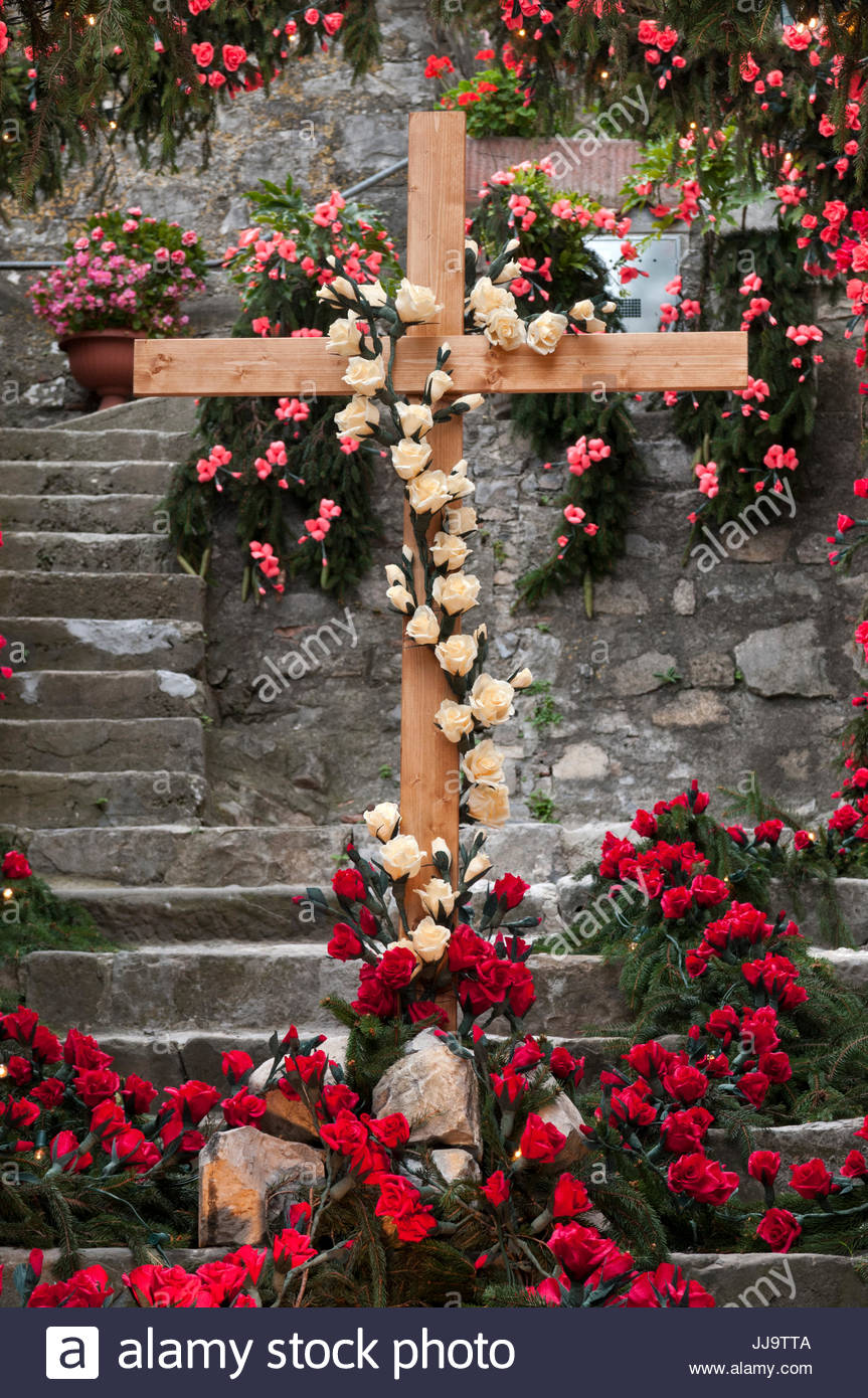 Pine branches and paper flowers decoration, Festa di Santa Croce, Carzano, Lake Iseo, Italy - Stock Image