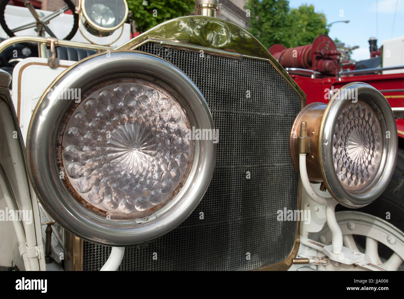Close-up of headlamps of an 1920 American LaFrance vintage firetruck. - Stock Image