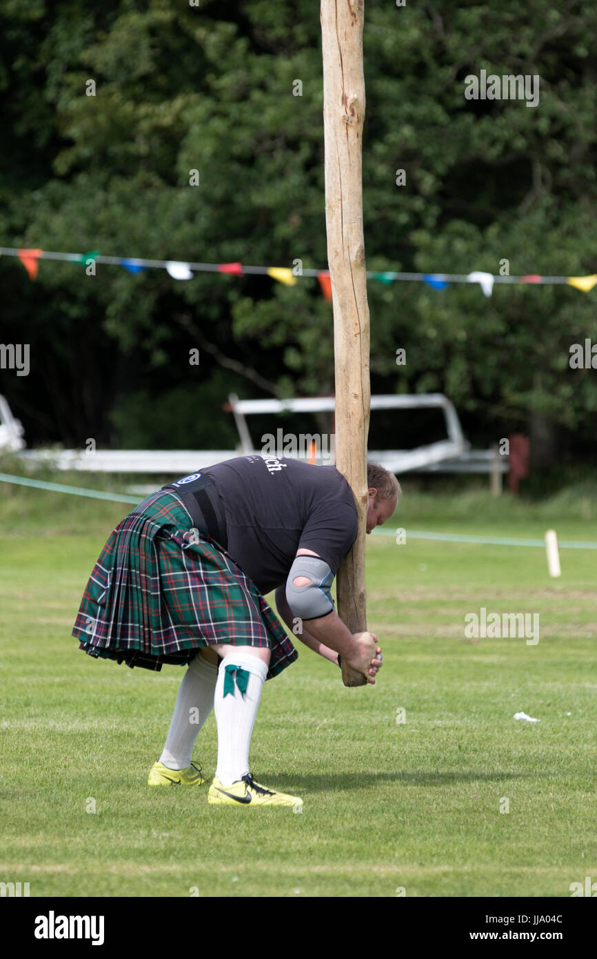 Stonehaven, Scotland - Jul 16, 2017: A competitor in the caber toss, a traditional Scottish Highland Games event, - Stock Image