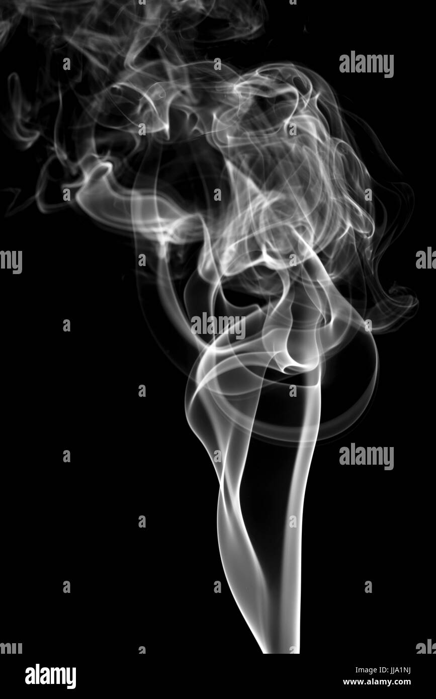 Smoke Against Black Background - Stock Image