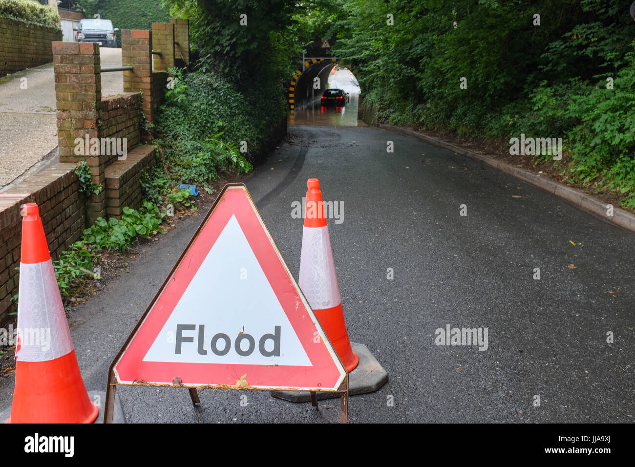 Basing, Hampshire. 19th July, 2017. A driver waits for help on Wednesday morning after their car gets stuck in a - Stock Image