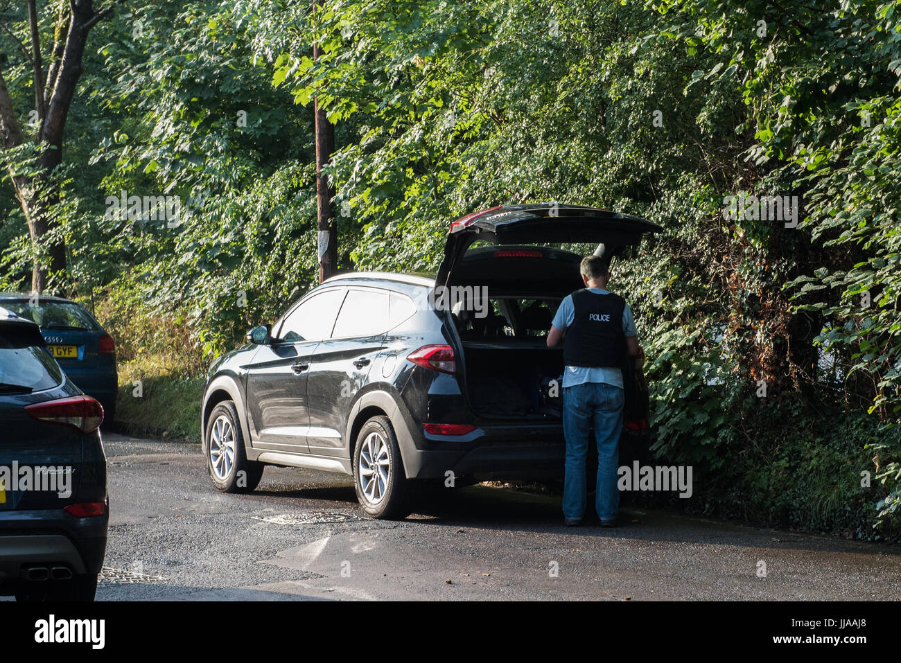 High Wycombe, United Kingdom. 19th July 2017. Police outside a property in High Wycombe that was raided as part - Stock Image