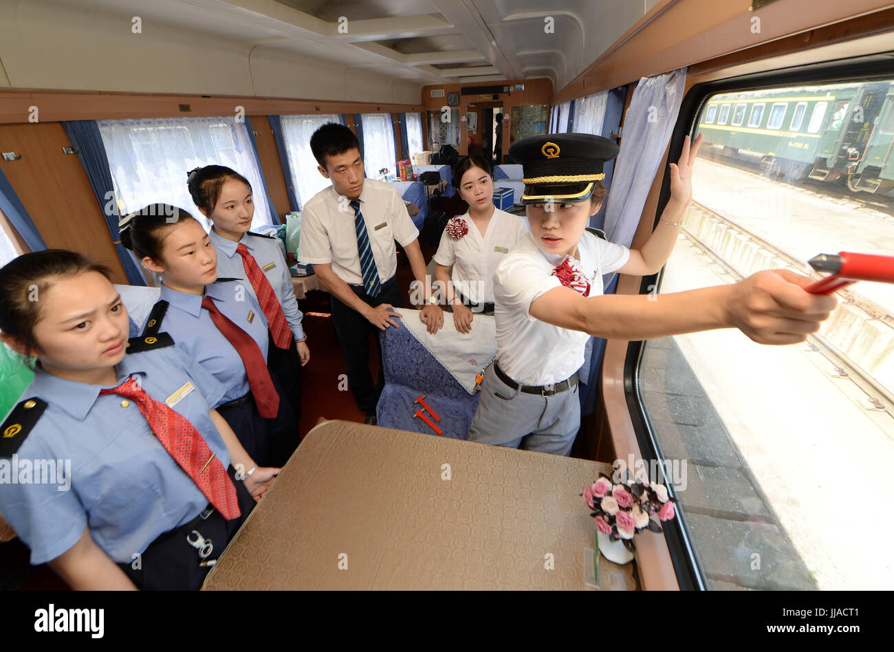 Nanchang, China's Jiangxi Province. 19th July, 2017. Newly-recruited stewards learn to use safety hammer on - Stock Image