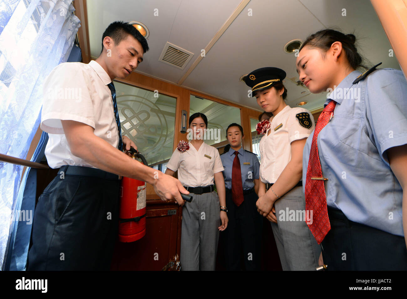 Nanchang, China's Jiangxi Province. 19th July, 2017. Newly-recruited stewards are trained to use firefighting - Stock Image