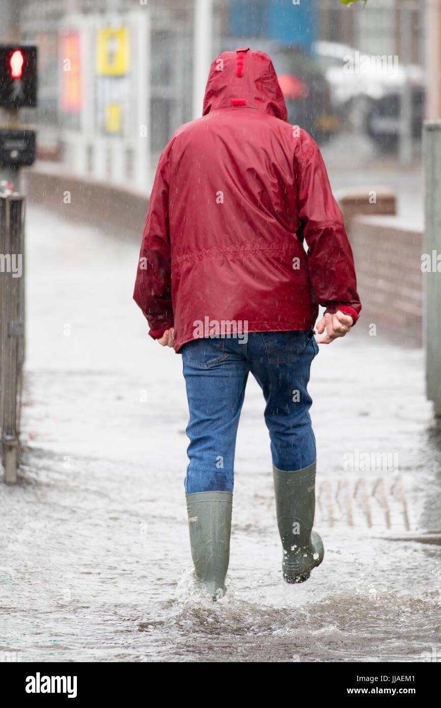 Man Wading Through Flood Stock Photos & Man Wading Through ...