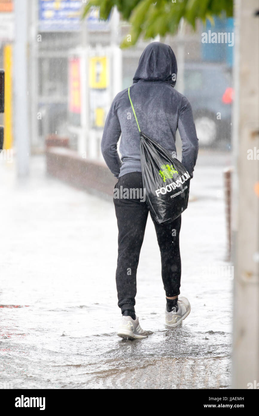 Man Walking Through Flood Water Stock Photos & Man Walking ...
