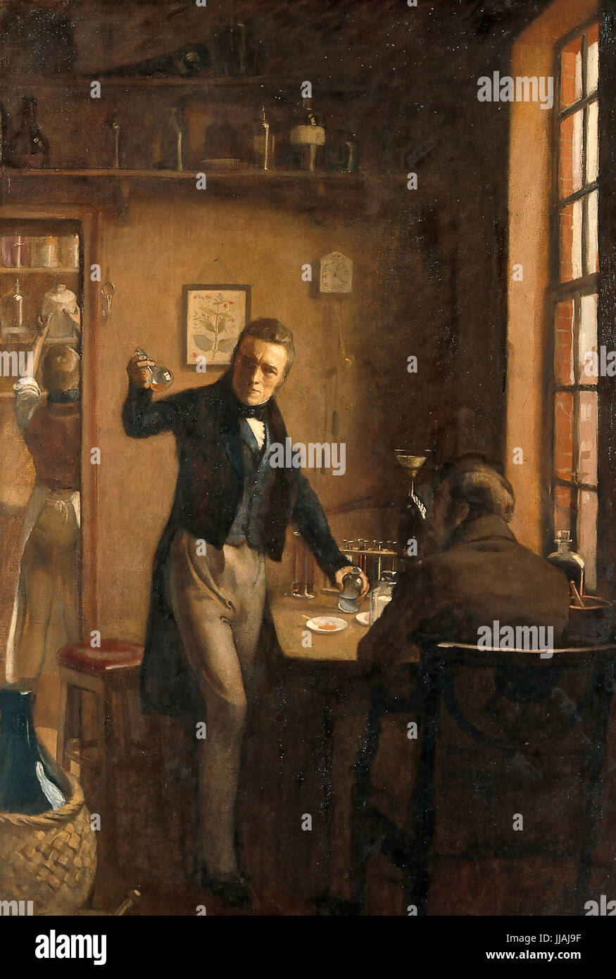 PIERRE JOSEPH PELLETIER (1788-1842) French chemist at left with Joseph Caventou shown discovering the alkaloid of - Stock Image