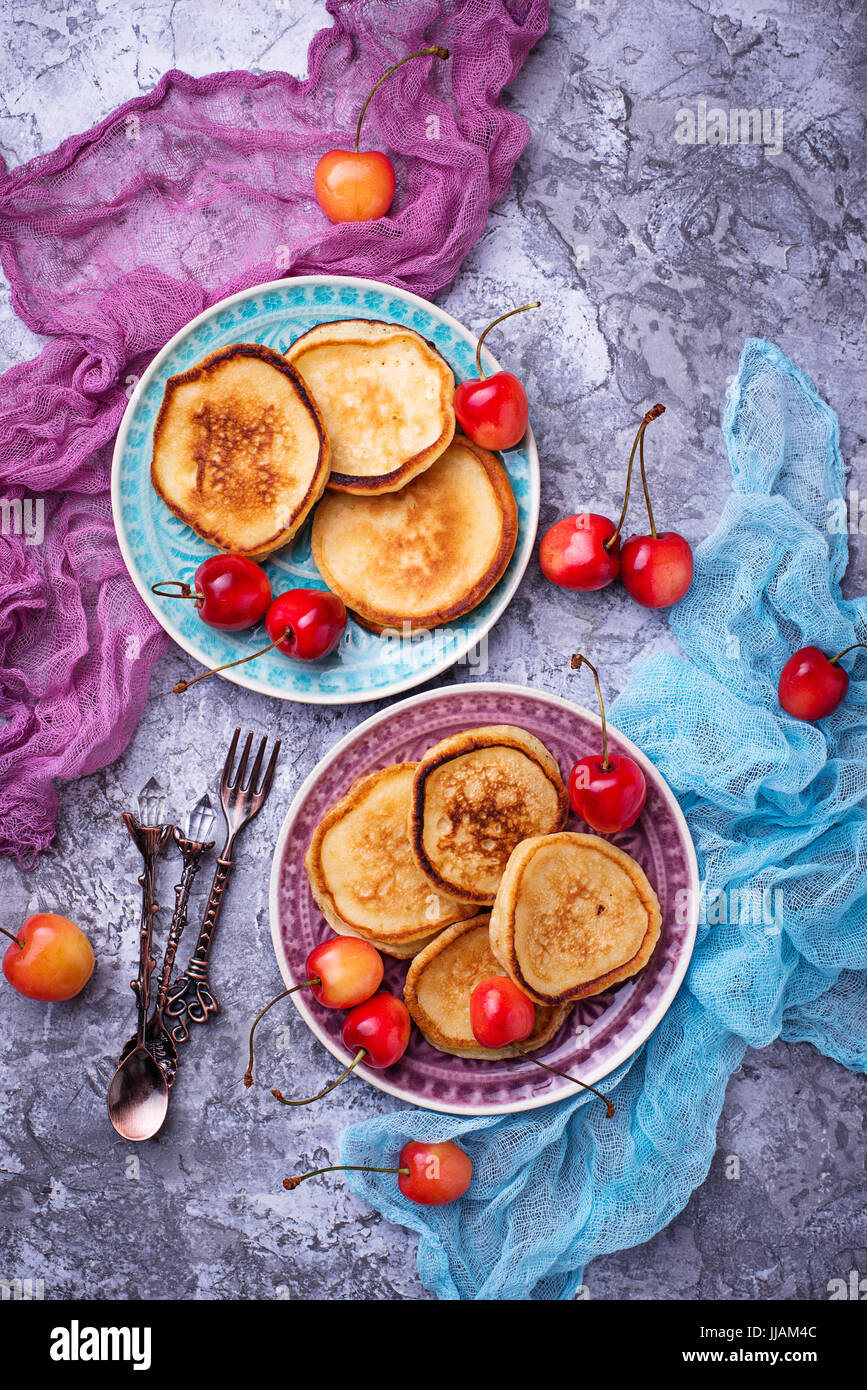 Pancakes with cherry. Selective focus - Stock Image
