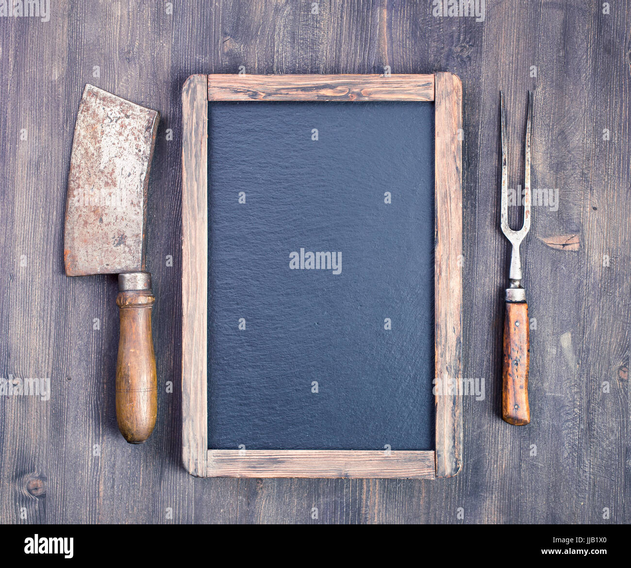 Rustic blackboard with meat cleaver and fork Stock Photo: 148989736 ...