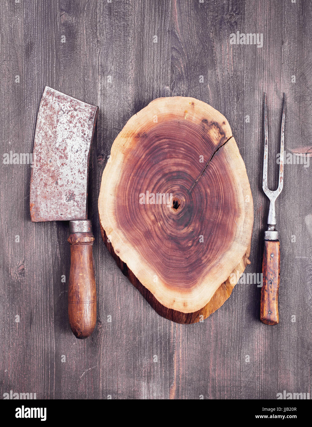 Wooden cut with cleaver knife and fork - Stock Image