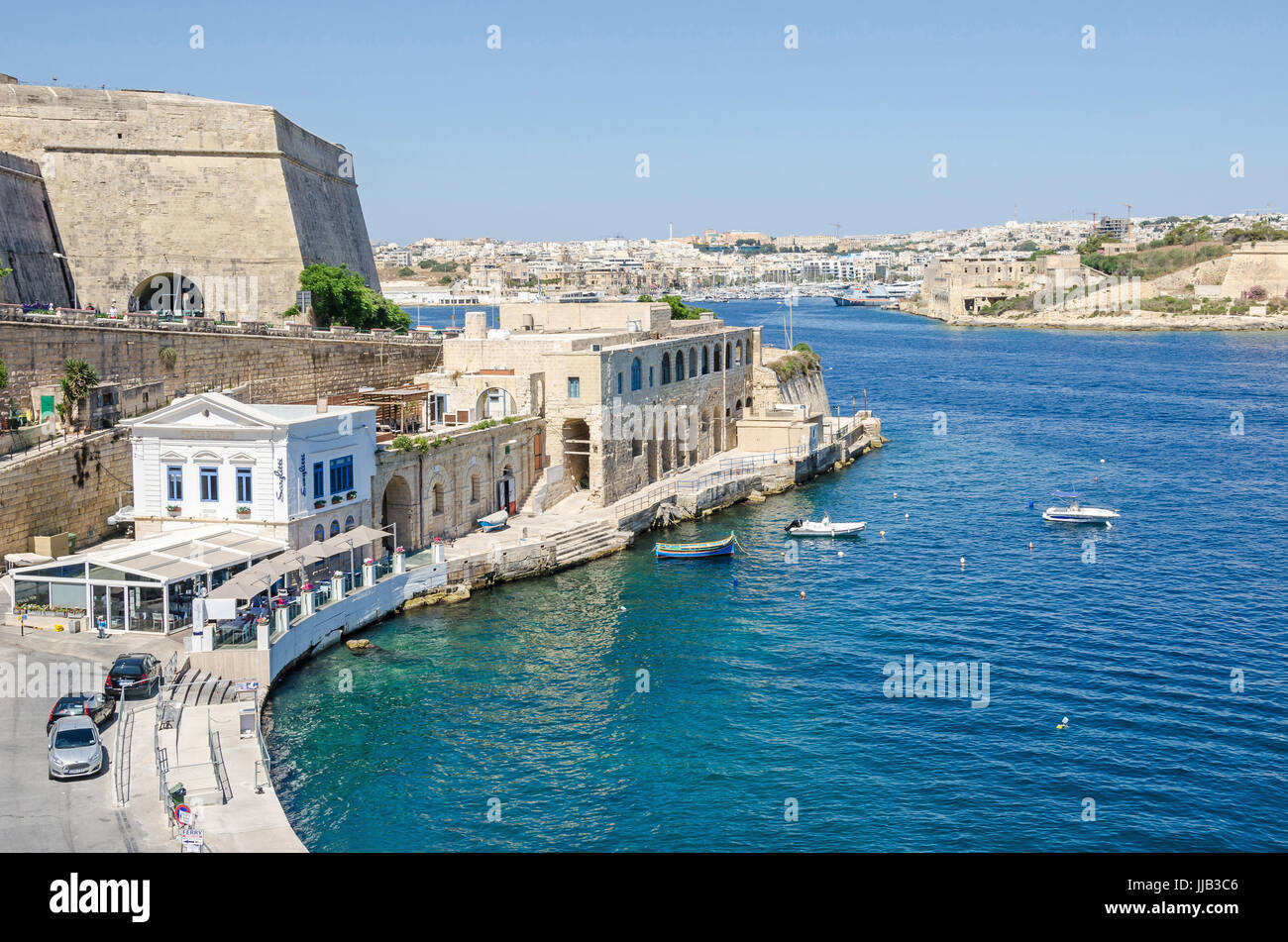 Valletta, Malta - June 4, 2017: View of Marsamxett Harbour with the fortification wall of the bastion, the restaurant - Stock Image