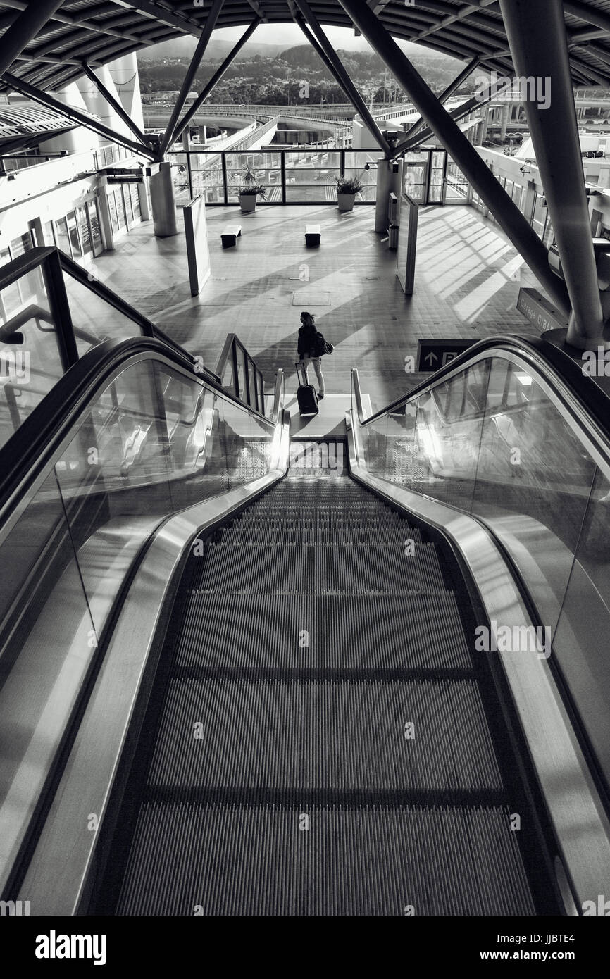 Escalator in train station at San Francisco International Airport. - Stock Image