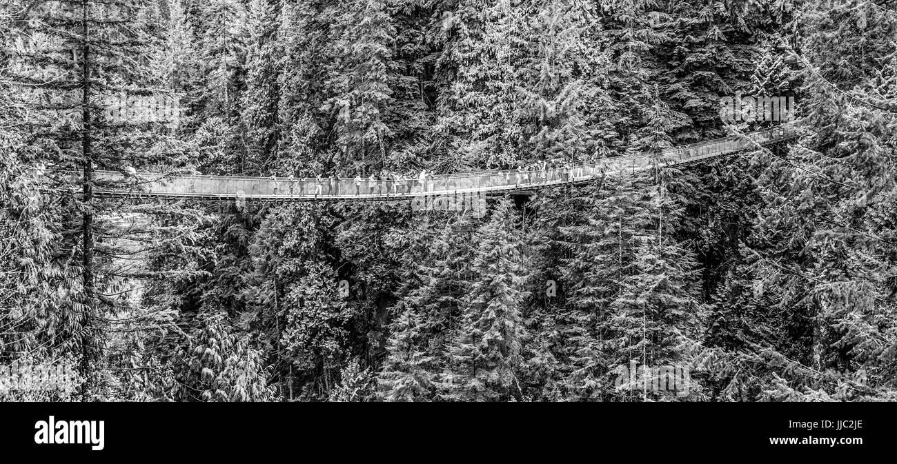 Famous Capilano Suspension Bridge in Canada - CAPILANO - CANADA - APRIL 12, 2017 - Stock Image