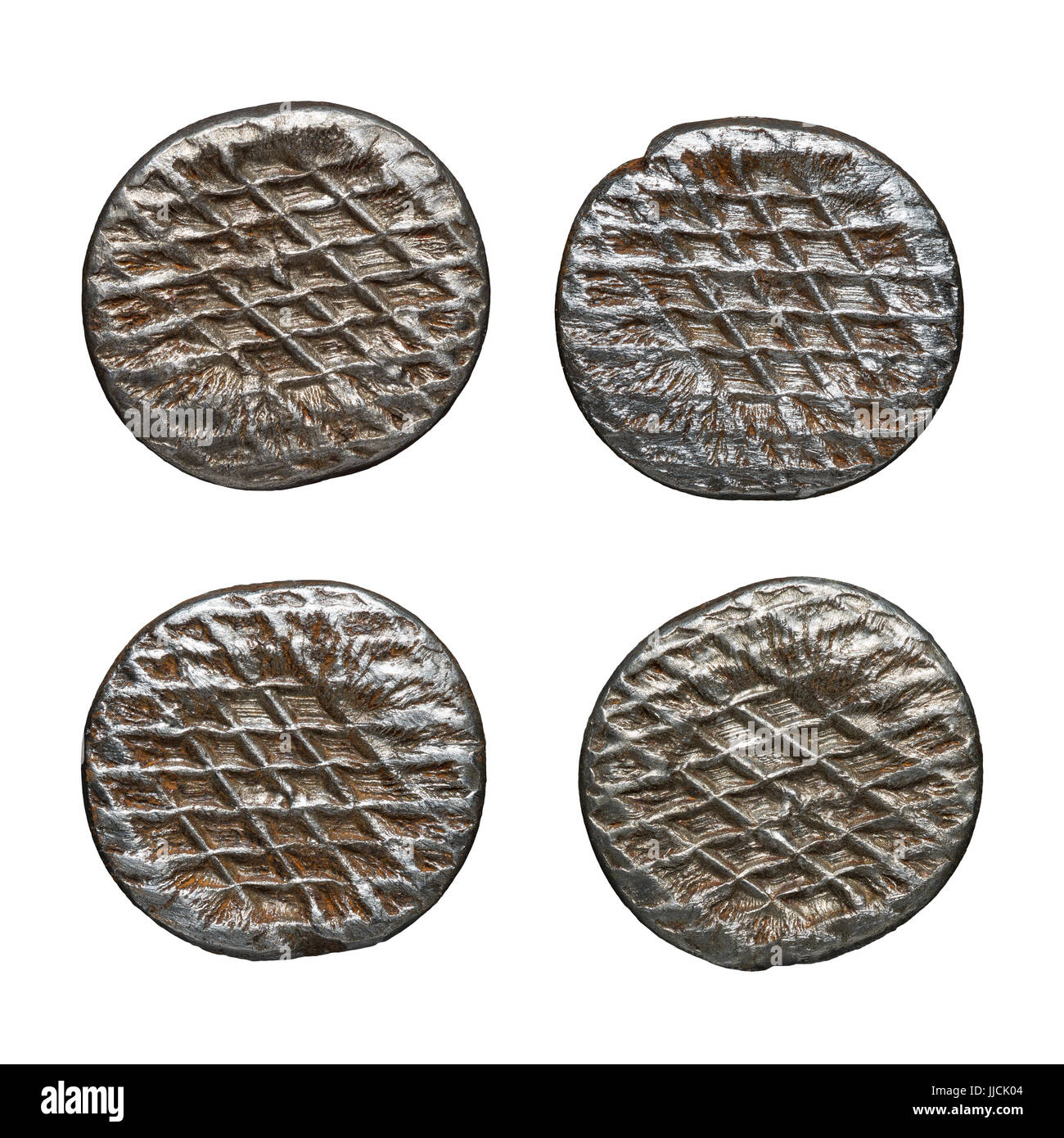 Old rusty nail heads, isolated on white. - Stock Image