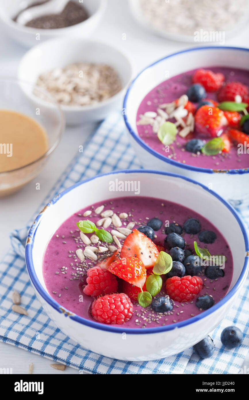 healthy berry smoothie bowl with strawberry blueberry raspberry and chia seed - Stock Image
