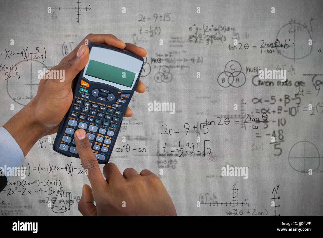 Hands Of Businessman Using Calculator Against Mathematical Problems