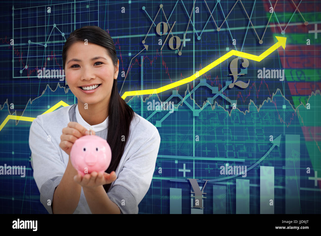 Charming businesswoman saving money in a piggybank against red arrow - Stock Image