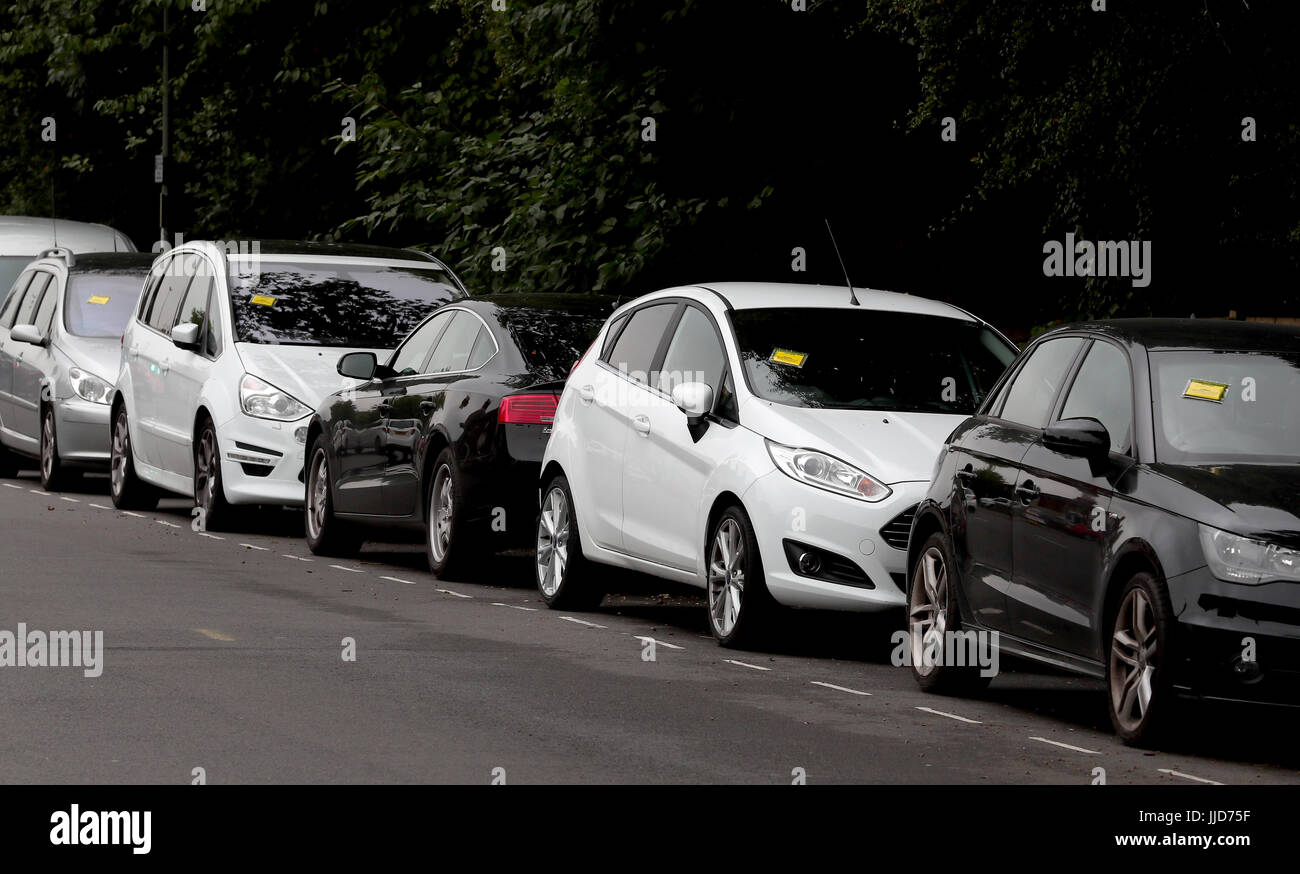 Penalty Charge Notices Affixed To Several Cars Left In Restricted