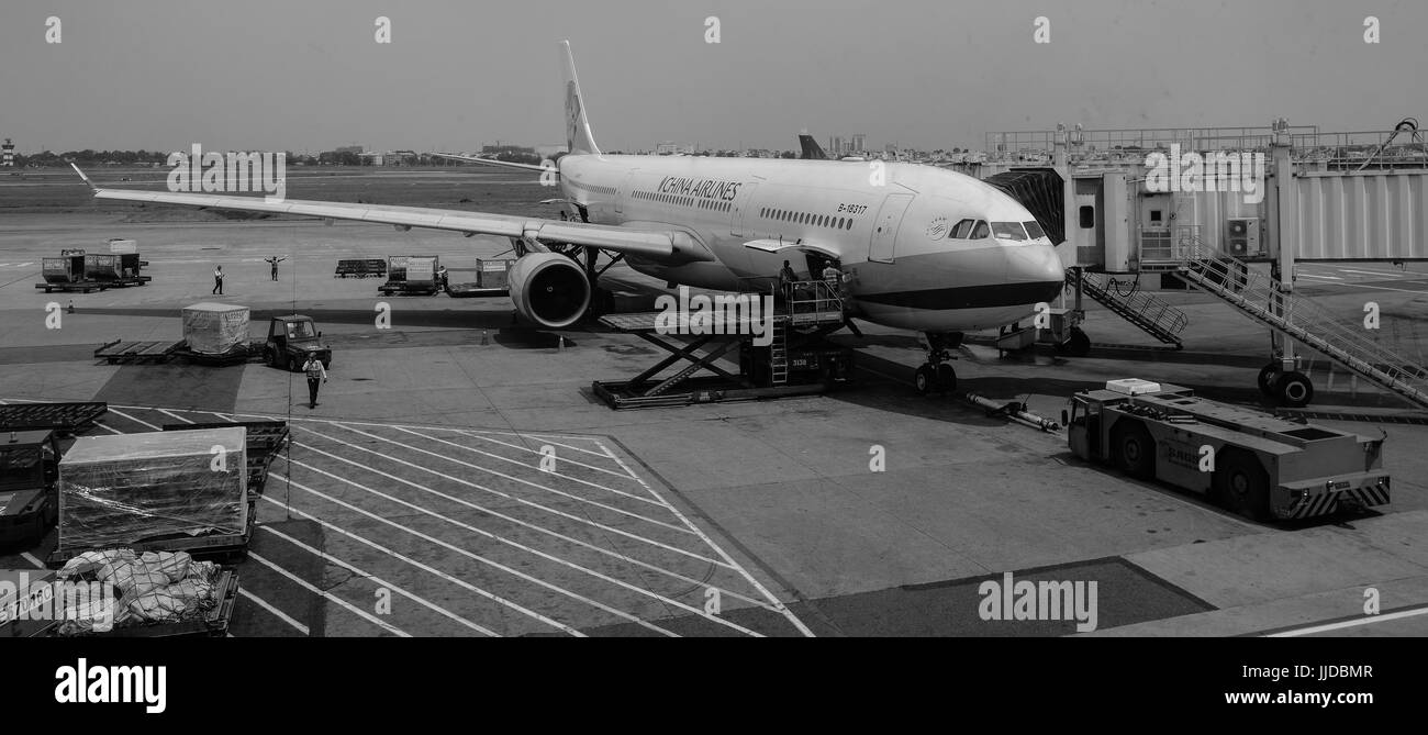 Saigon, Vietnam - Mar 9, 2016. A civil airplane docking at Tan Son Nhat Airport in Saigon, Vietnam. Saigon is the - Stock Image