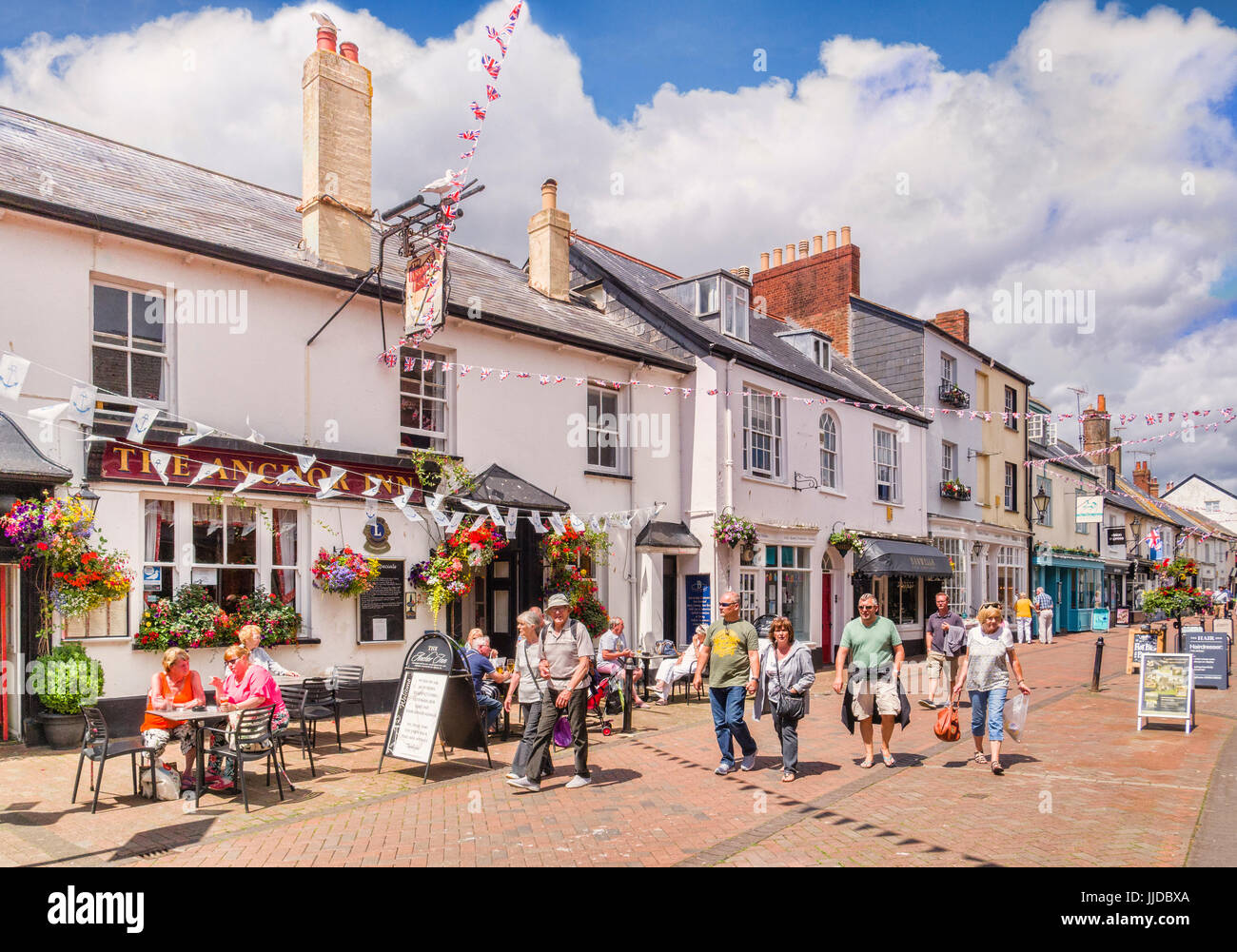 3 July 2017:  Sidmouth, Dorset, England, UK - Shoppers in Old Fore Street, beside The Anchor Inn, on a sunny summer - Stock Image