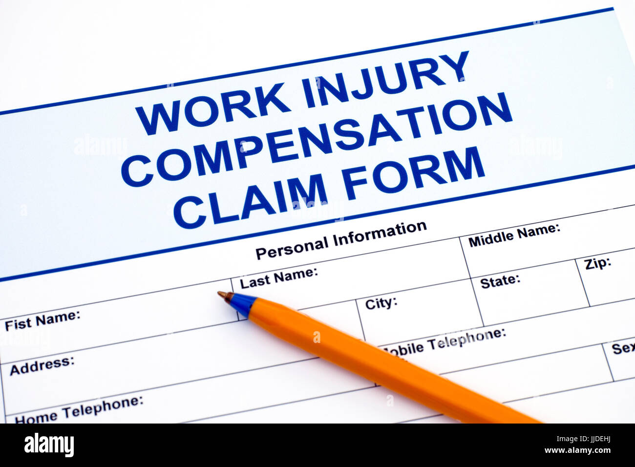 Work Injury Compensation Claim Form with ballpoint pen - Stock Image