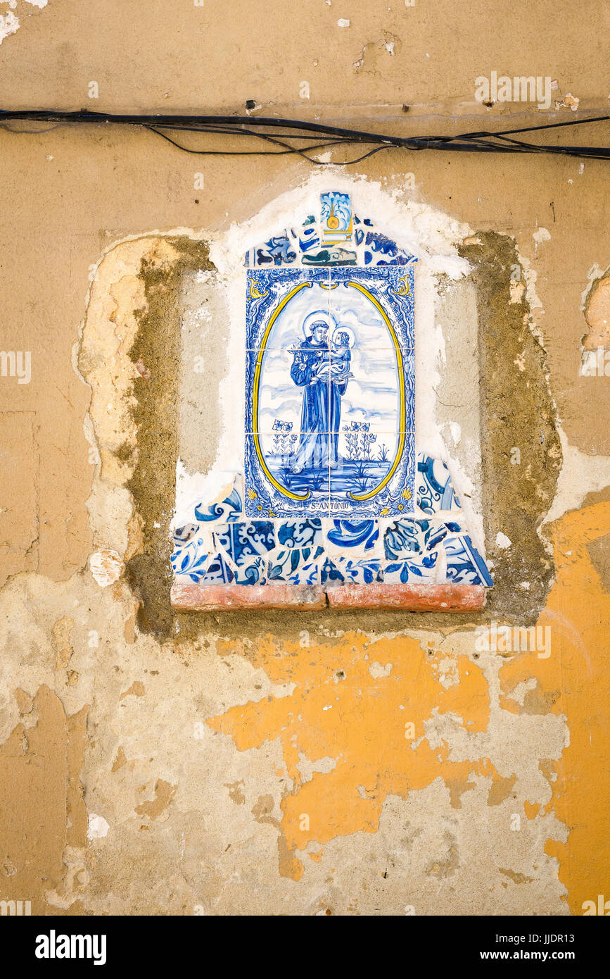 Azulejos Lisbon, remains of a neighbourhood shrine in the Alfama district of Lisbon depicting Saint Anthony in blue - Stock Image