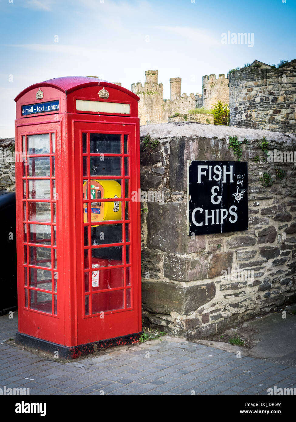 Defibrillator in a Phone Box - a traditional British Telephone Kiosk has been repurposed to hold a public defibrillator - Stock Image