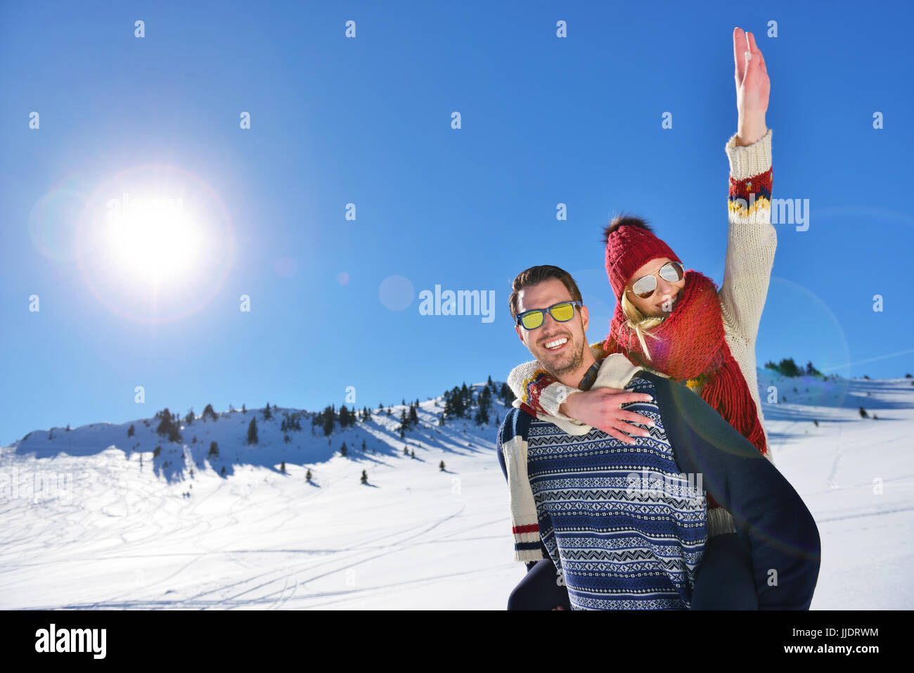 Loving couple playing together in snow outdoor. Stock Photo