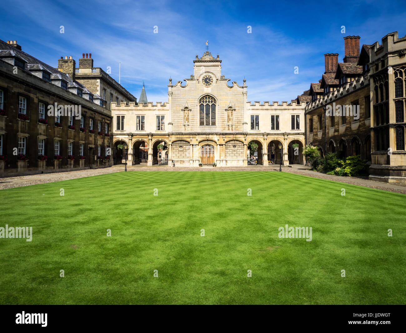 Cambridge - the Clock Tower and Lawns of Peterhouse College, part of the University of Cambridge. The college was - Stock Image