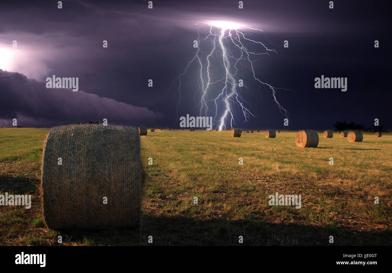 Straw bales and storm Stock Photo