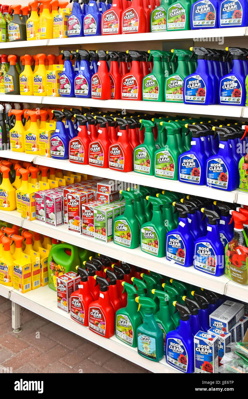 Garden centre shelf gardening chemical plastic spray bottles of weed killers pest control of bugs general garden - Stock Image
