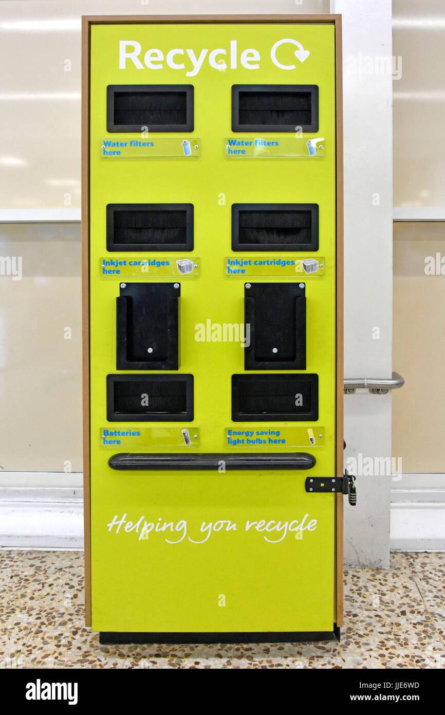 Recycling bin in supermarket store customers dump minority household products Water Filters Inkjet Cartridges Batteries - Stock Image