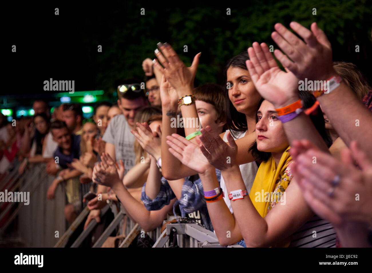 NOVI SAD, SERBIA - JULY 6, 2017: People applauding during the 2017 edition of the Exit Festival in Novi Sad, Serbia. - Stock Image