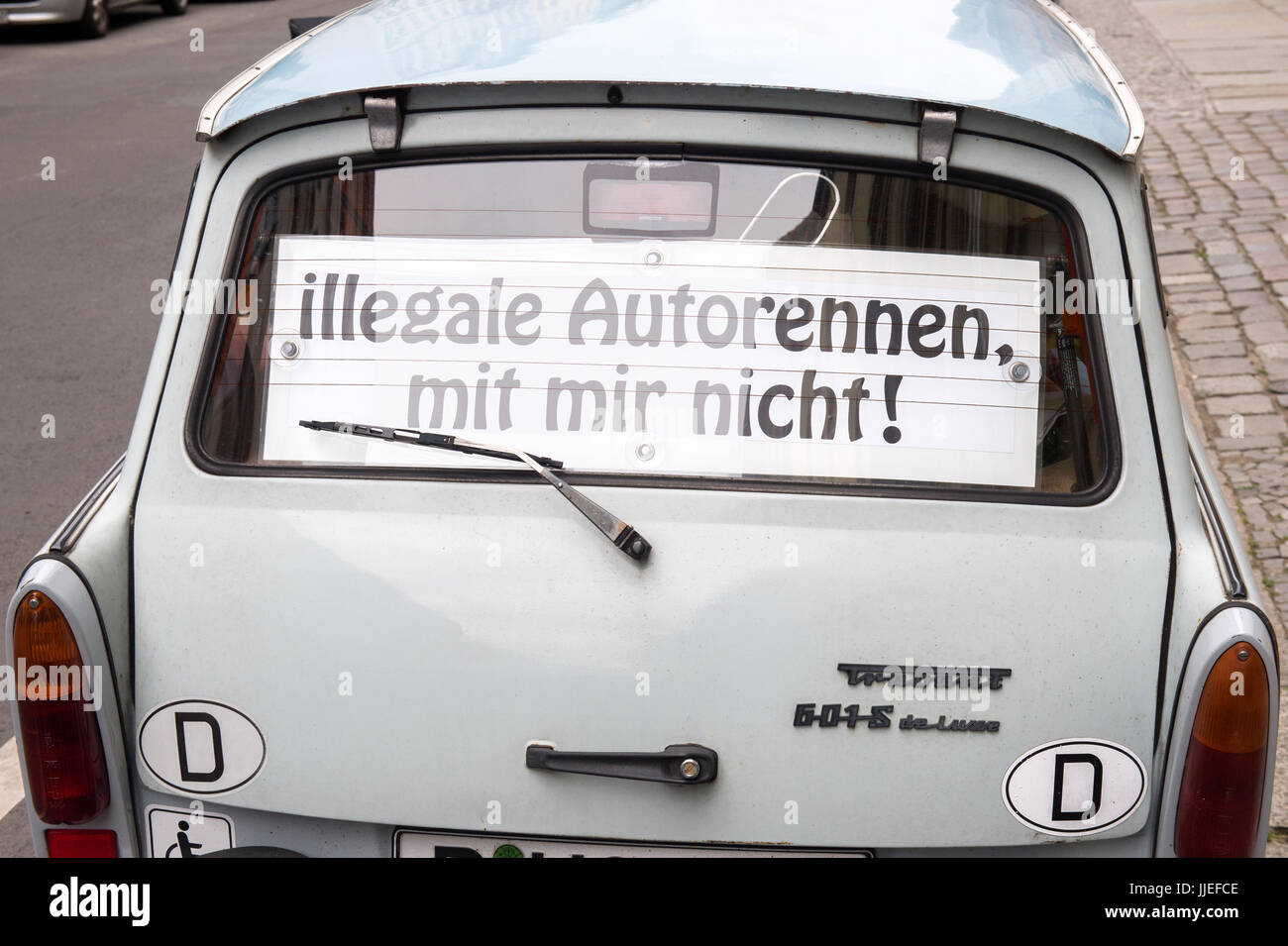 Berlin, Germany, Trabant with banner Illegale authors, with me not - Stock Image