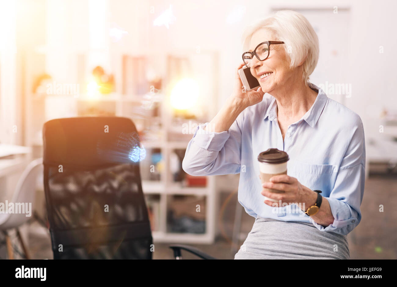 Charismatic respected businesswoman chatting on the phone - Stock Image