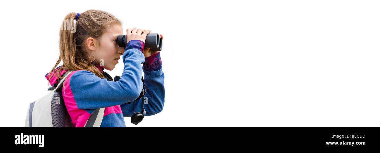 Young girl watching through binoculars on a clear background - Stock Image