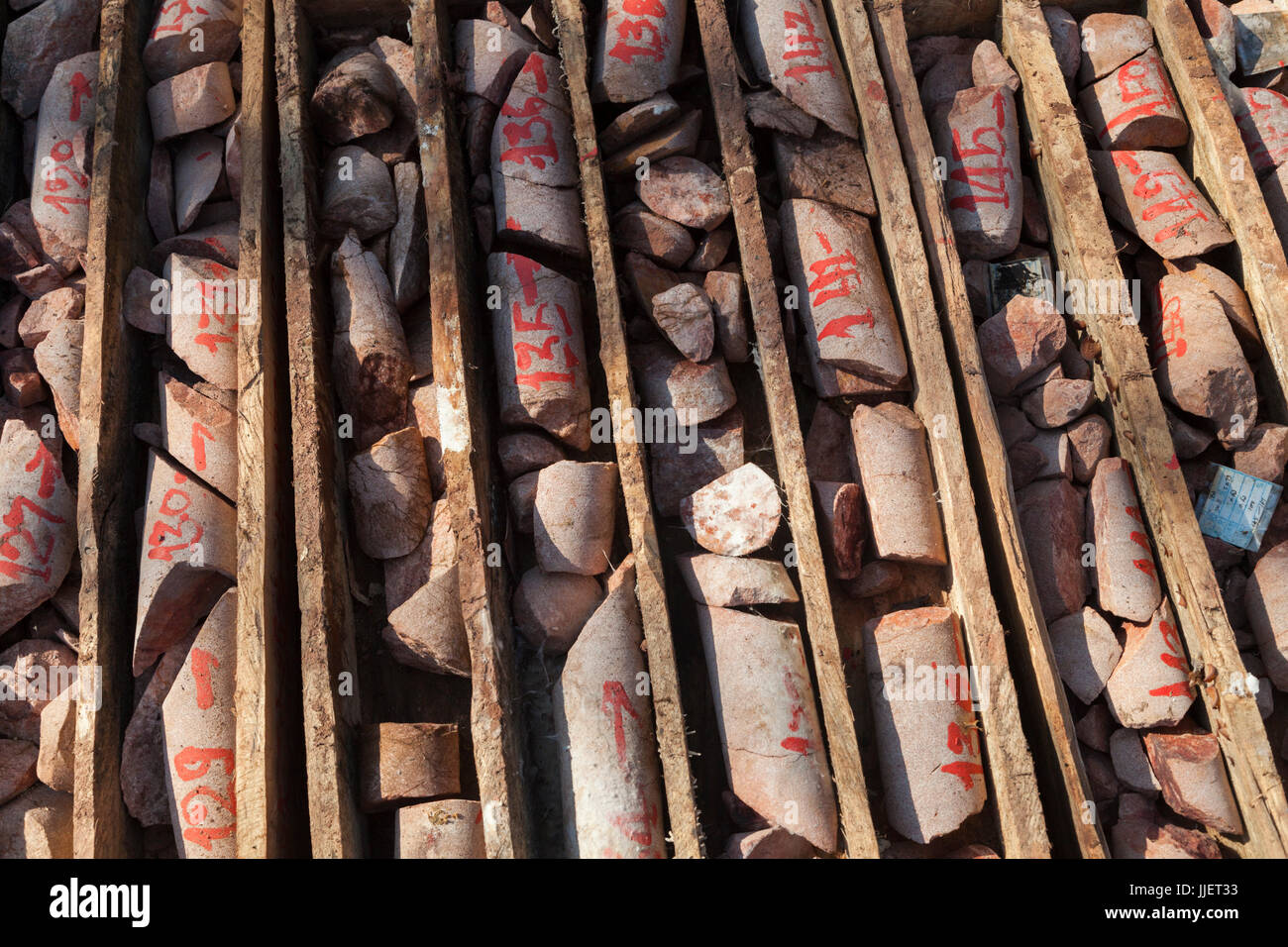 Labeled bedrock core samples collected by a drill rig from the bed of the Nam Ou River at the planned site for Dam - Stock Image