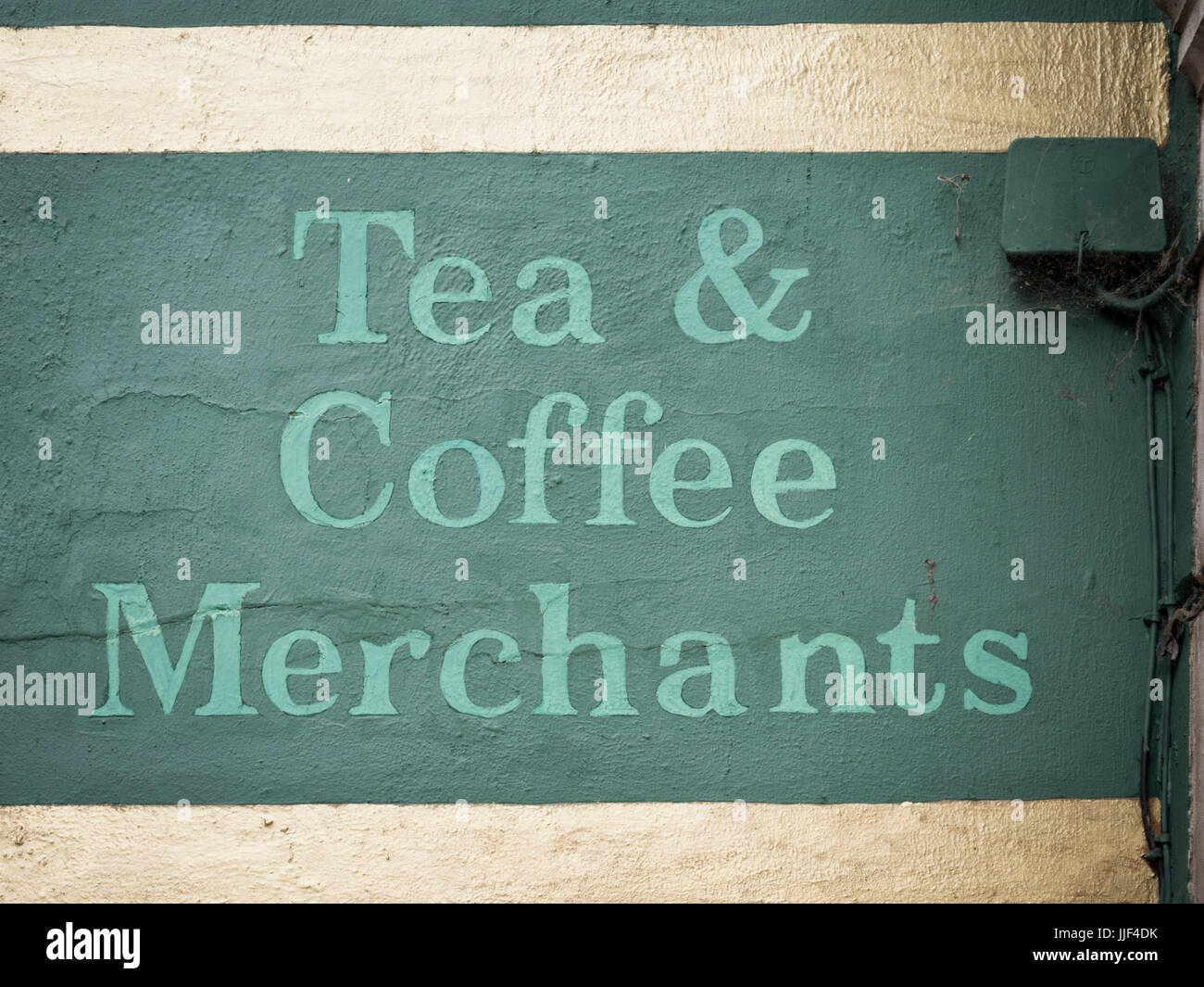 A sign for a tea and coffee merchant outside a shop - Stock Image