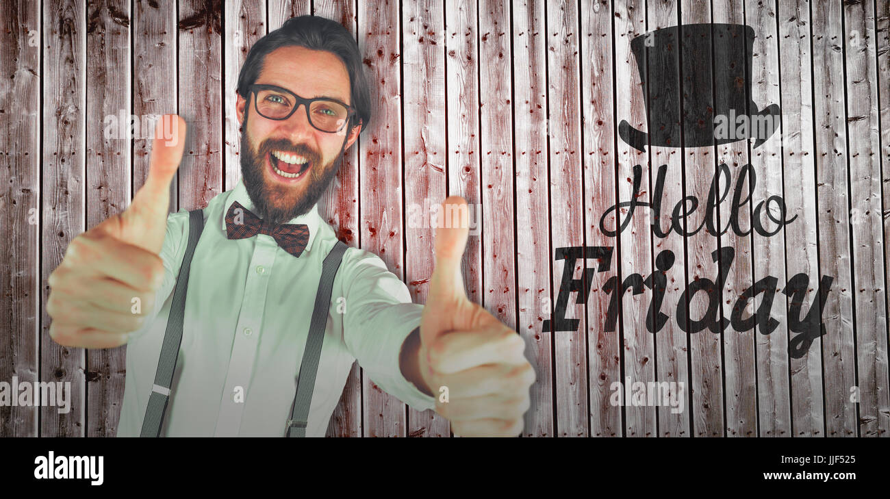 Tilt iamge of cheerful man showing thumbs against wooden planks - Stock Image