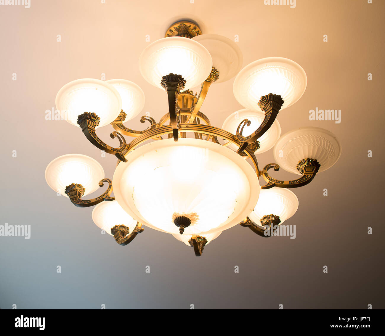 Home interiors Chandelier on ceiling(turn on the light) - Stock Image