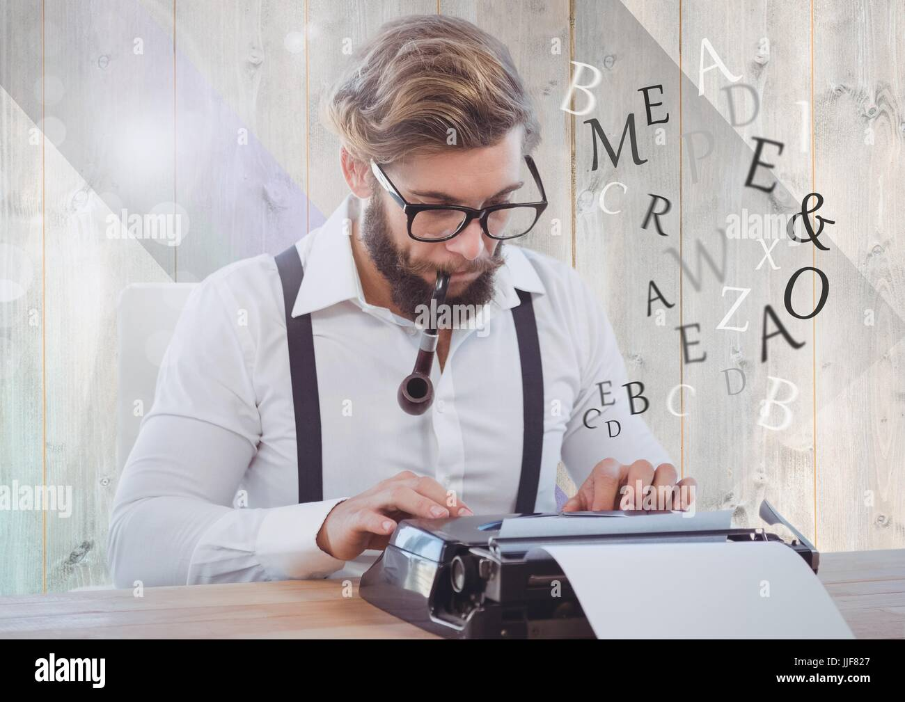Digital composite of Hipster man  on typewriter with letters - Stock Image